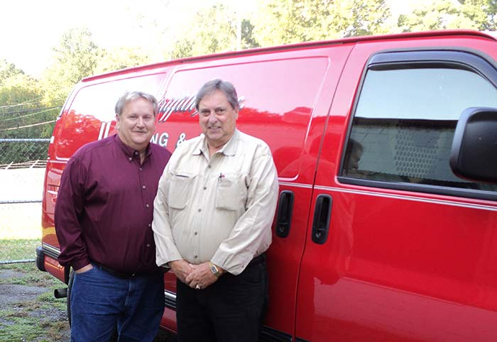 Acors & Griffith owners with truck